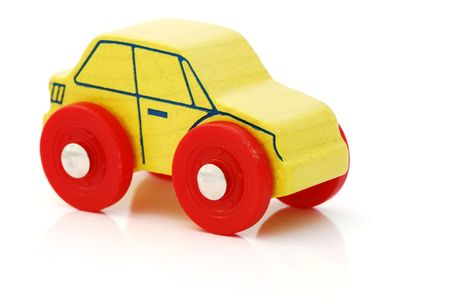 Yellow wooden car toy isolated on a white background Stock Photo