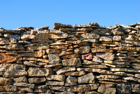 Wall made of stone and blue sky Stock Photo - 2323242