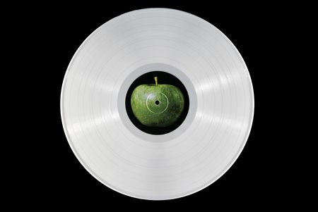 White 33 rpm record with an apple label. photo
