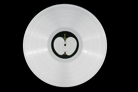 White 33 rpm record with an apple label.