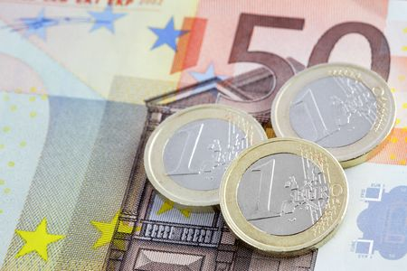 Close up view on euro coins on banknote