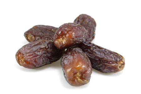 Close up view on dates fruits isolated on white