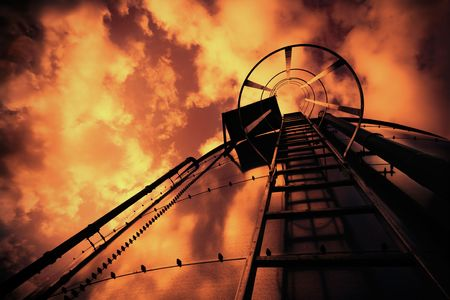 Cross processed low-angle shot of ladder on tank refinery. Stock Photo - 4029610