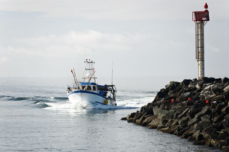 Fishing boat coming back to the harbour