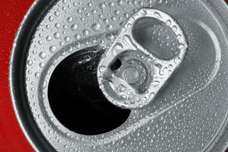 Macro of a open and wet refreshment can. Stock Photo