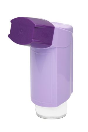 Purple asthma inhaler isolated on a white background photo