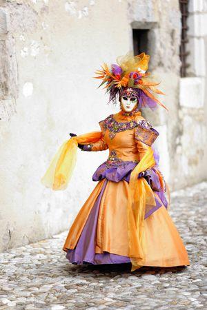 Orange dress costume in medieval street (AnnecyFrance)