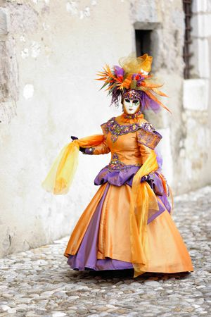 Orange dress costume in medieval street (AnnecyFrance)