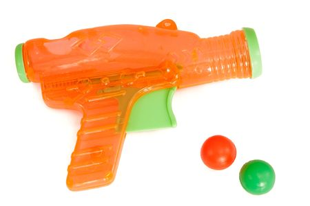 Orange plastic gun with bullets isolated on a white background