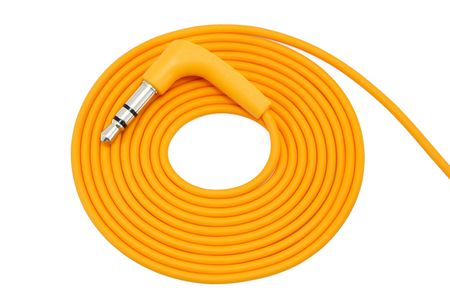 Wrapped orange cable with audio jack isolated on white photo