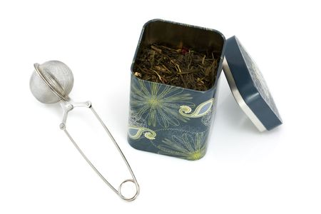 Tea strainer and can full of leaves Stock Photo - 6005590