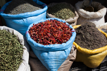 moroccan cuisine: Colorful spices at a Market stall in Morocco
