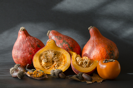 decorative pumpkins and autumn leaves for halloween Stock Photo
