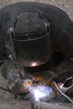 the welder welds pipes for gas installation