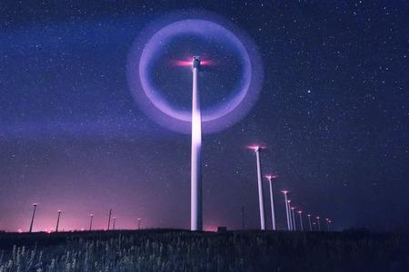 beautiful night photo of wind generators and stars with abstract lighting Archivio Fotografico - 101825382