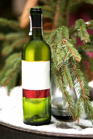 Composition of wine bottle on bright background photo