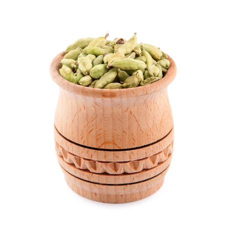 cardamum: Cardamon in wooden bowl isolated on a white Stock Photo