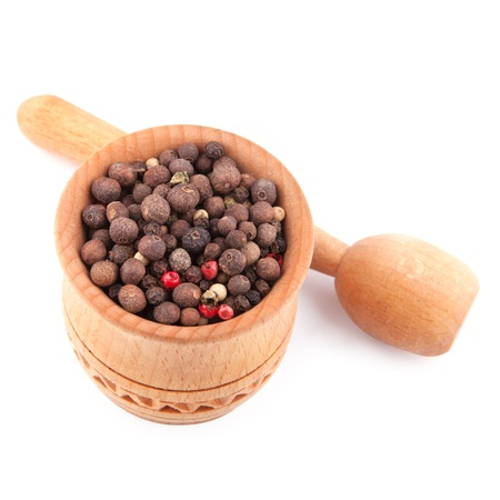 indian cookery: Peppercorn in a wooden bowl isolated on a white Stock Photo