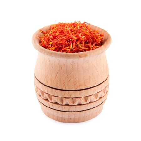intense flavor: Saffron in wooden bowl isolated on a white