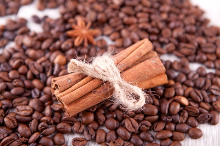 cinnamon sticks and scattered coffee beans photo