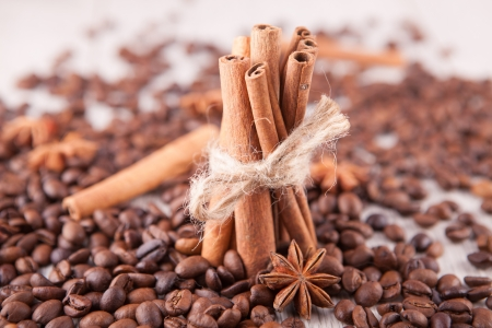 Cinnamon sticks, star anise and  scattered coffee beans photo