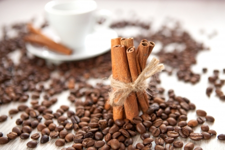Cinnamon with scattered coffee beans photo