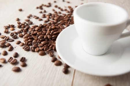 coffee cup with coffee beans on a wooden board photo