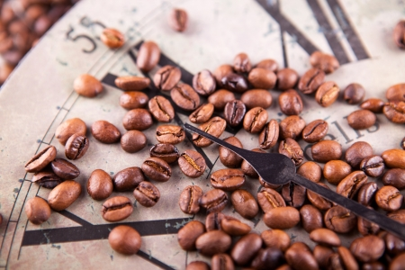 vintage clock and coffee beans scattered photo