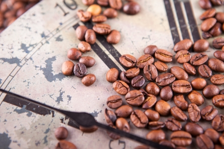 vintage clock and coffee beans scattered texture photo