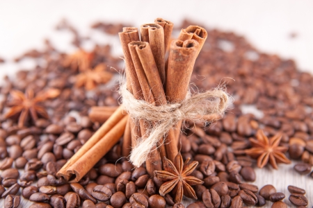 star anise, cinnamon sticks and coffee beans scattered photo