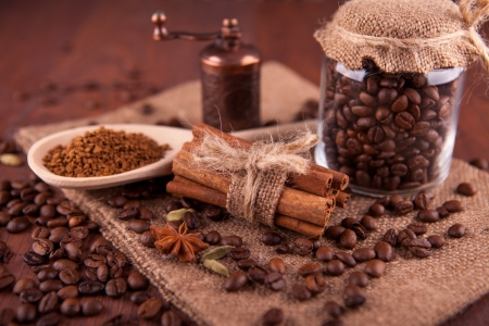 coffee beans and cinnamon on a wooden board