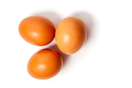 boiled eggs: Three eggs on the white background