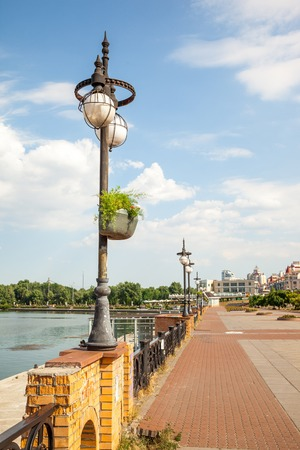dnepr: Lanterns on the green embankment in sunny day