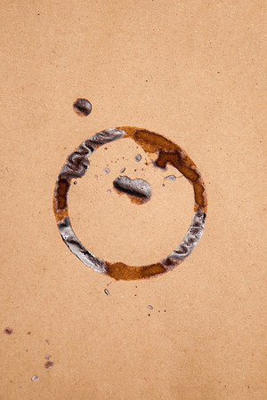 stain: Brown paper sheet texture with coffee stain