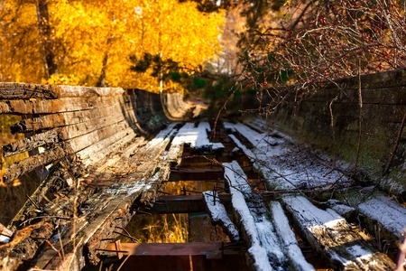 bobsled: Abandoned broken bobsled slide in the autumn forest