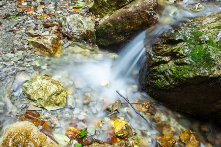 Small source of water in the rocks. Picture with a long exposure