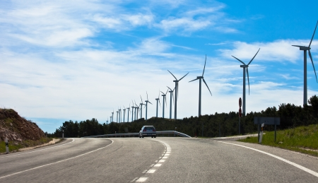 The road in the mountains with windmills photo