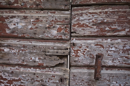 texture of an oldwood wall with the door handle photo