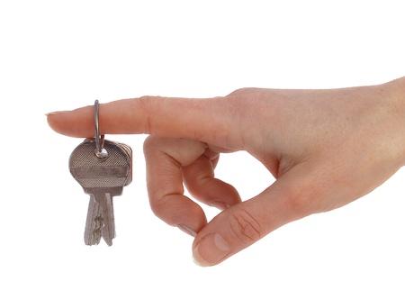 metallic keys hanging on forefinger  isolated Stock Photo - 17537088