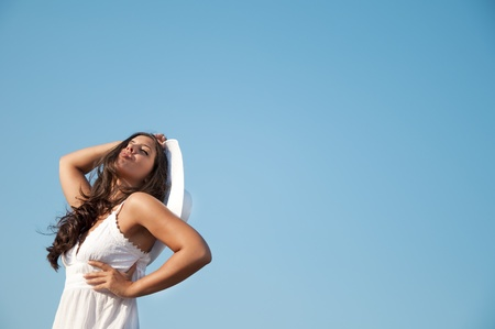 Woman in sky with hat photo