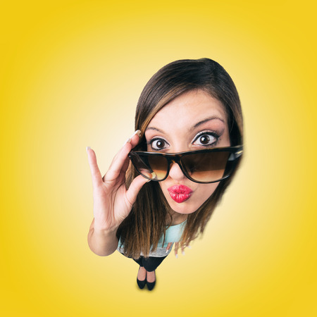 fish eye lens: Funny Kissing Girl with Sunglasses looks like caricature of herself, fish eye lens shot