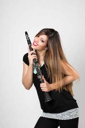 attractive woman in love with her clarinet Stock Photo