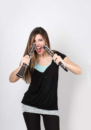 Crazy woman with clarinet divided in half