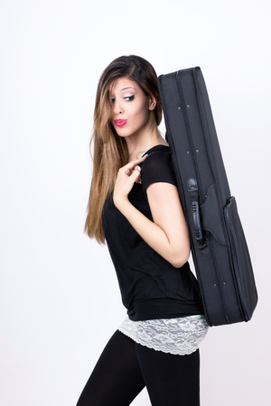 sweet student girl with her instrument case Stock Photo