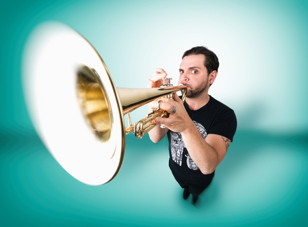 Funny man is playing trumpet Stock Photo