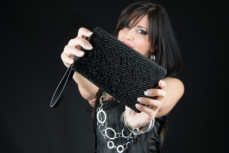 Attractive woman with her Jewelry bag. Close up