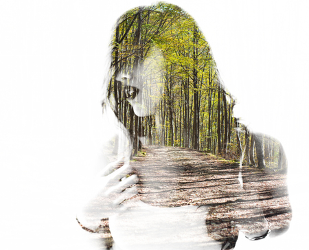 exposición: Portrait of a young woman with the effect of double exposure, nature style