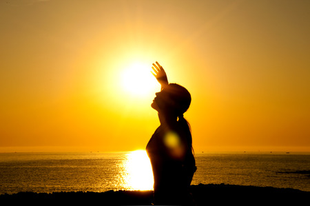 A beautiful girl silhouette free in the sun Stock Photo