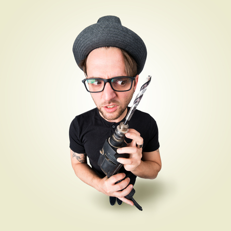 Funny crazy man with drill from above Stock Photo