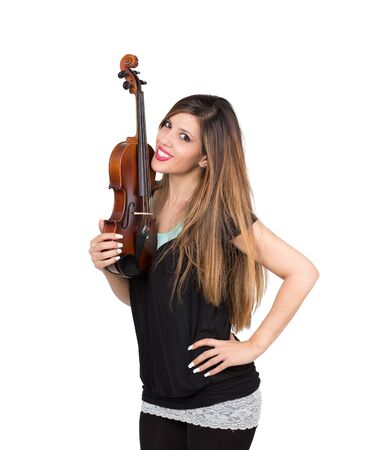 smiling beautiful woman with her violin in hand Stock Photo